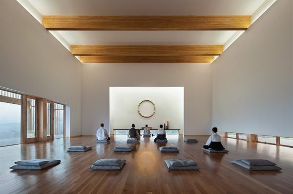 Meditation hall interior, with windows that frame views of the distance.