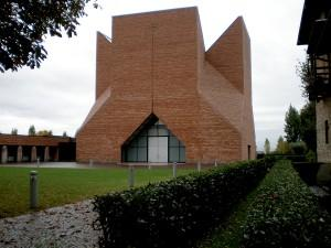 Mario Botta's Holy Pope Giovanni XIII Church in Seriate, Italy has a longitudinal cross carved into the front façade.