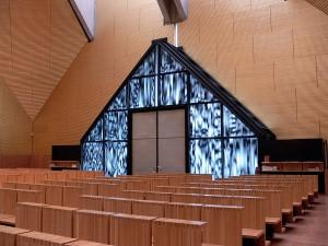 Church entrance from the interior is a projected half-diamond shape.