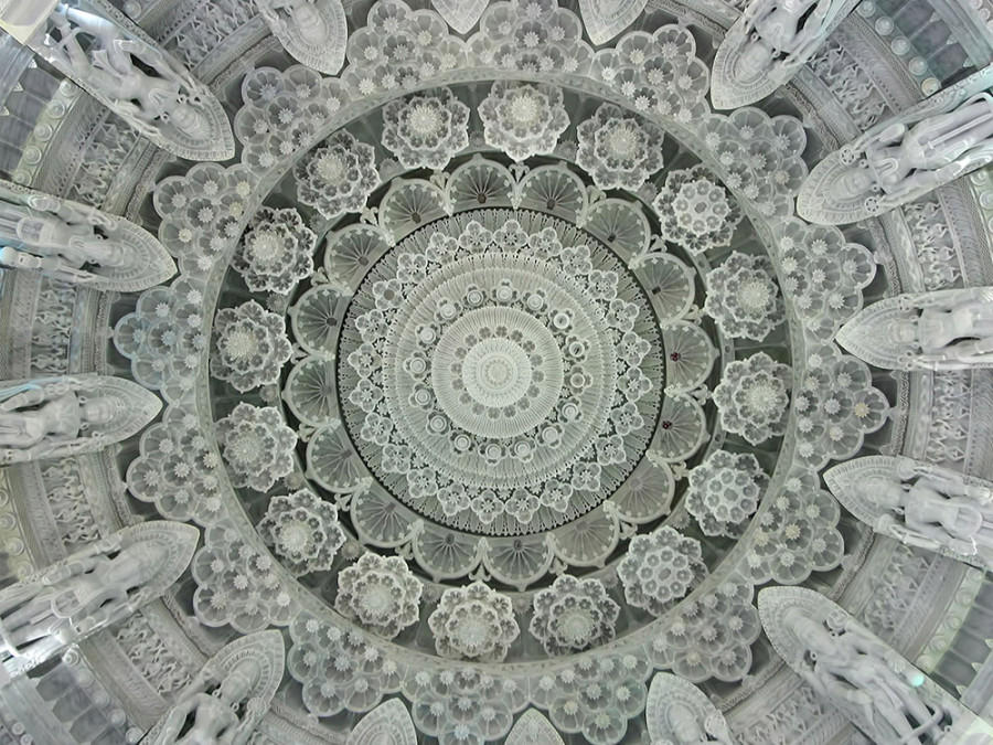 Stone-carved main dome interior of the Sri Swaminarayan Mandir, Houston.