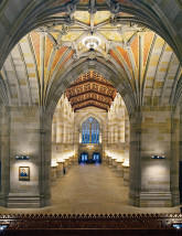 Cleared of display cases, desks, and card catalogues, the now-empty nave at dusk is especially lovely, even welcoming. The lighting is now pronounced, revealing especially the stained American oak coffered ceiling and the re-discovered colors of the ceiling in the 'crossing.'