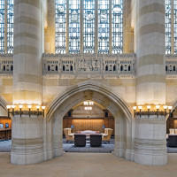 The stained glass in the 25-foot-high windows by G. Owen Bonawit is actually a pale yellow. The unsigned stone frieze depicts the library's history. This view into the reconceived and now carpeted and furnished south aisle shows the built-in wall of card catalogues.