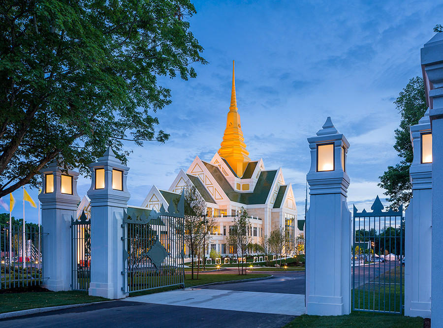Multiple gable forms (common in Thai temples) and a 185-foot steeple blend Eastern and Western design themes.