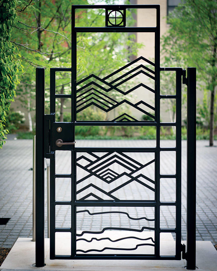 Landscape gate design references the mountains and rivers of West Virginia.