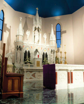 The old altar, which survived the tornado, graces the new church's chancel.