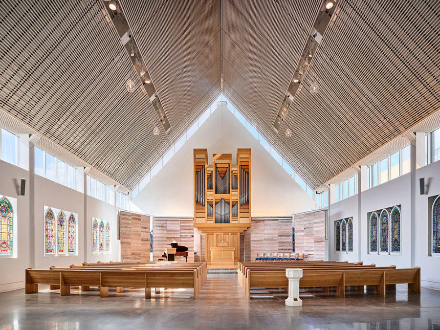 New sanctuary is designed and constructed within the footprint of the old, with salvaged stained glass and font.