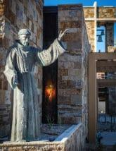 Detail near the entrance of the church conveys the presence of St. Francis of Assisi.