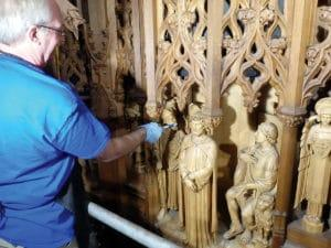 Cleaning the reredos.
