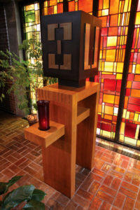 Saint Leo Catholic Church bronze tabernacle on red oak stand