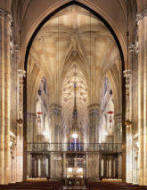 Bronze-framed glass wall shields Lady Chapel.